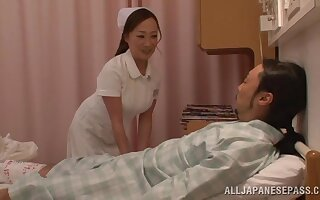 Cute Japanese nurse takes off her clothes forth ride a lucky guy