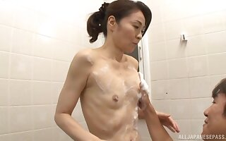 Small boobs Japanese chick Asou Chiharu drops heavens her knees to blow