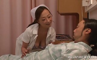 Asian be fond of gives a blowjob and rides his dick on get under one's hospital bed