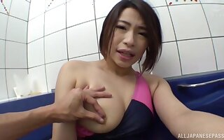 Japanese wife Mayama Riko flashes her tits and gives a blowjob
