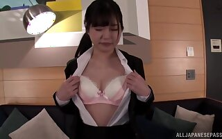 Amateur Japanese wife flashes her tits and plays with a vibrator