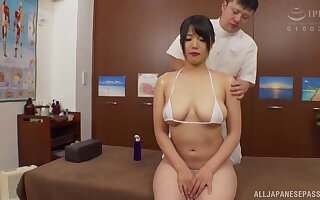 Hot wife Sachiko drops her bikini to be fucked during a massage