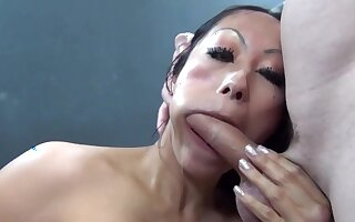 Close up video of Asian hooker Gia sucking and riding a giant cock