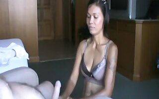 Asian chick on her knees
