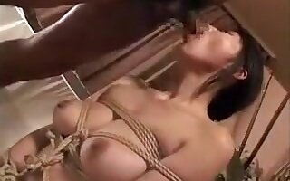 Big Breasted Oriental Beauty Gets Tied Up And Chokes On A L