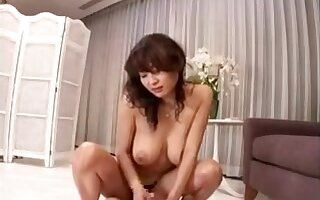 Seductive Asian mistress with big boobs teases and pleases