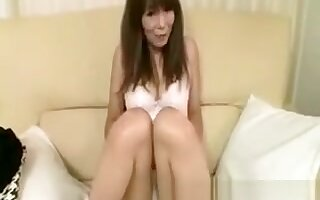 Busty asian cougar getting naked